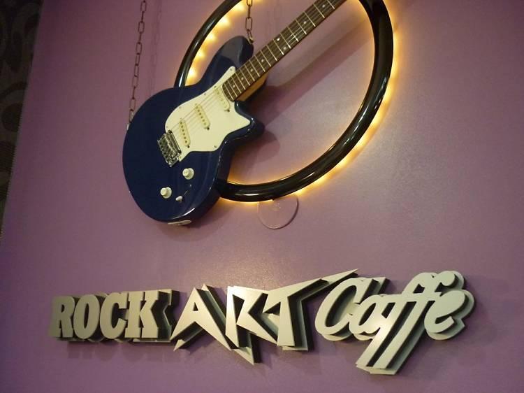 Shoot pool at the Rock Art Caffe