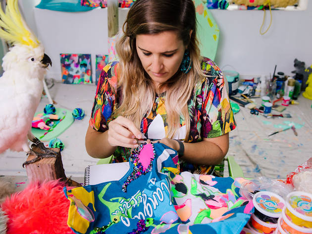 Artist Rosie Deacon sewing sequins on fabric