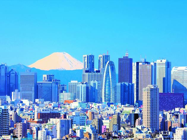 View Mount Fuji in contrast with the urban skyline of Tokyo
