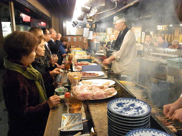 Mingle with salarymen at a small Yakitori stall under the train station in Shimbashi