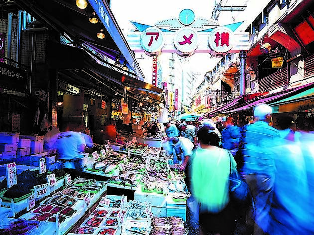 Experience the authentic air of an old Japanese shopping street at Ameyoko and eat street food