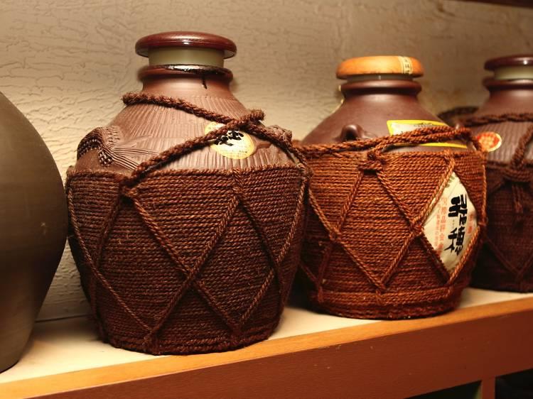 Have glass (or five) of awamori, Okinawa's local tipple