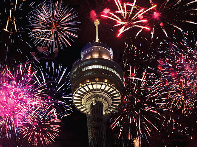 Sydney Tower with fireworks around it.