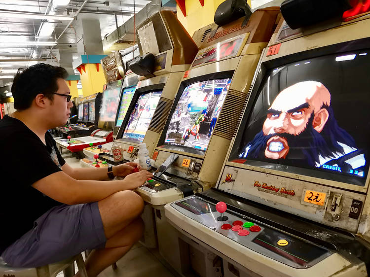 Exhaust your dollar coins at a video game arcade
