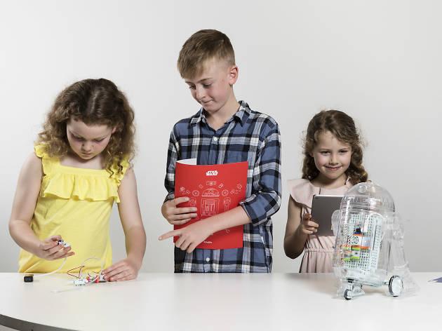 Kids building a robot.