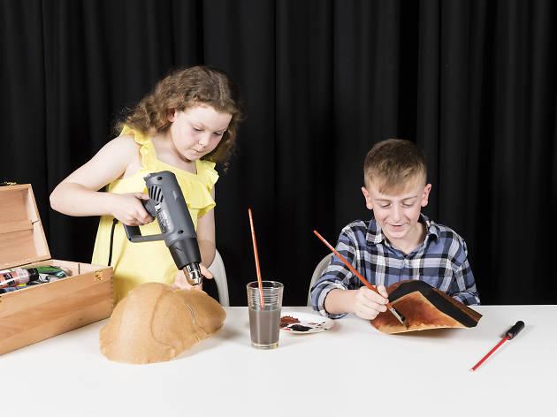 Kids doing craft.