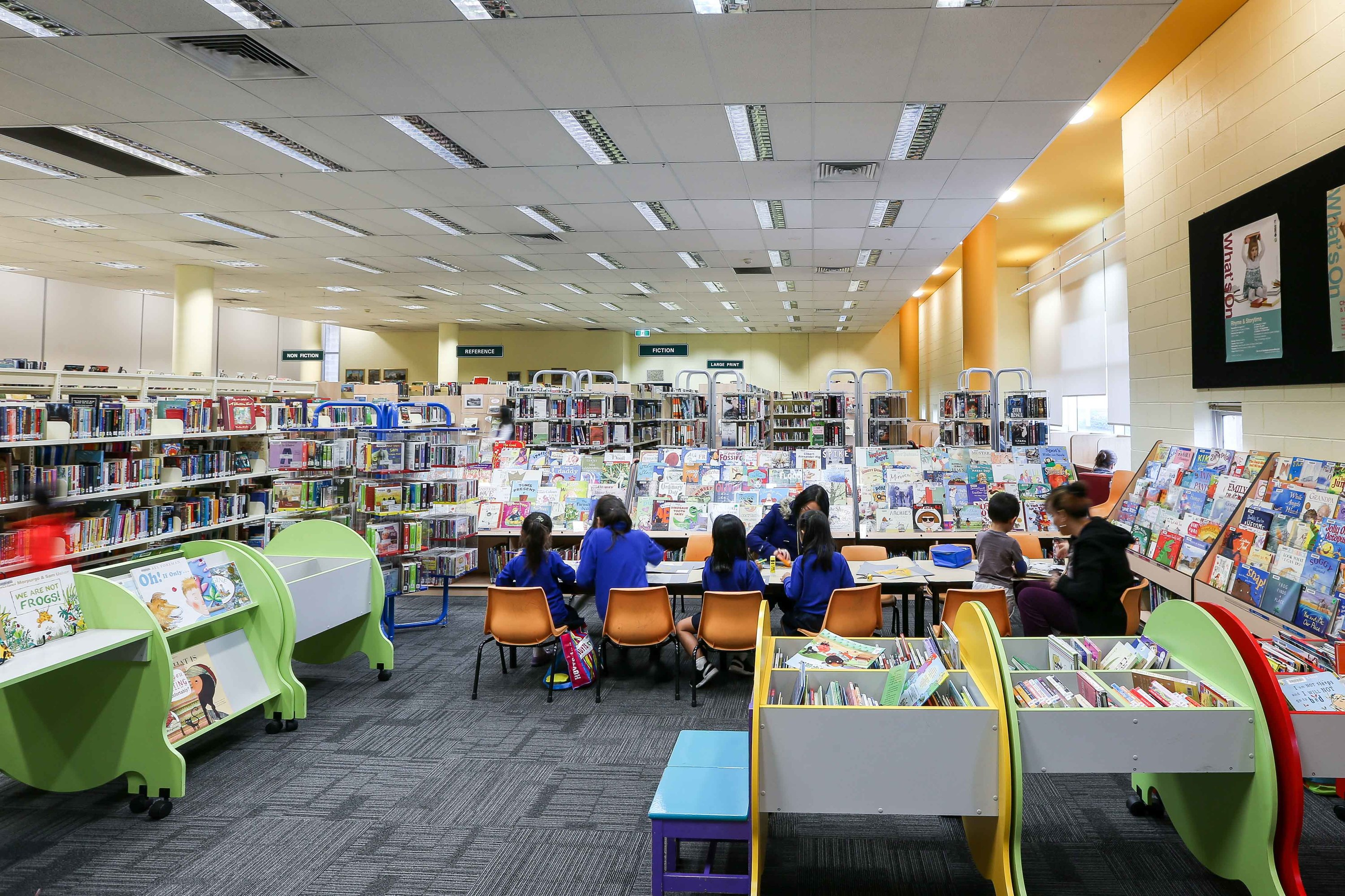 Children sitting at a table at Ultimo Library