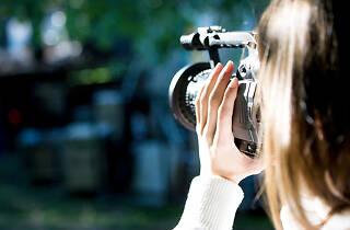 Woman shooting a video camera.