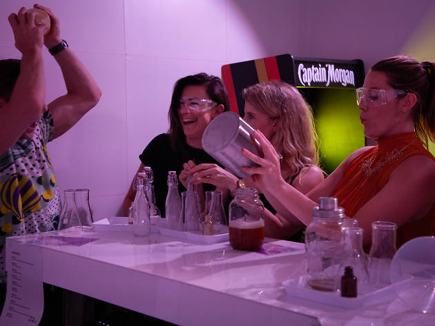 People playing with science beakers.