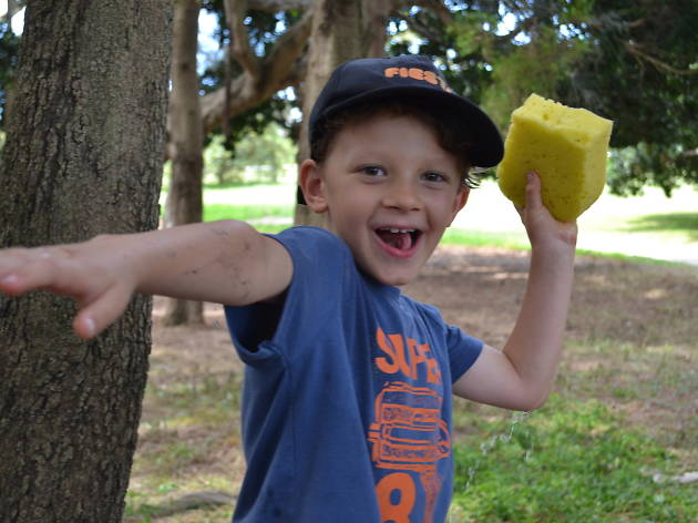 Boy throws a sponge.