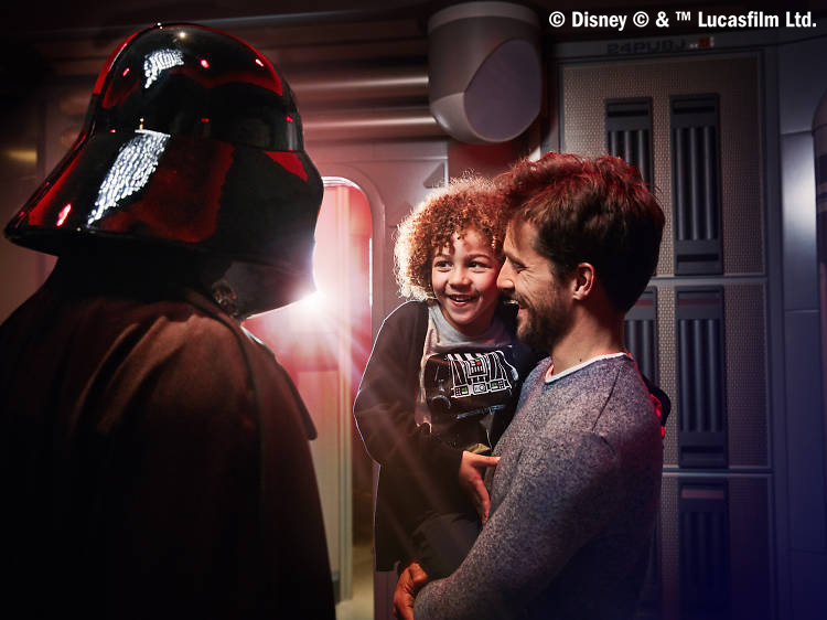 Do not reuse. COPYRIGHT ADDED. Meeting Darth Vadar - Disneyland Paris Legends of the Force campaign.