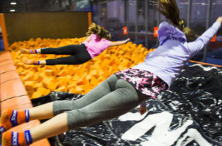 Kids jumping into the foam pit at Sky Zone.