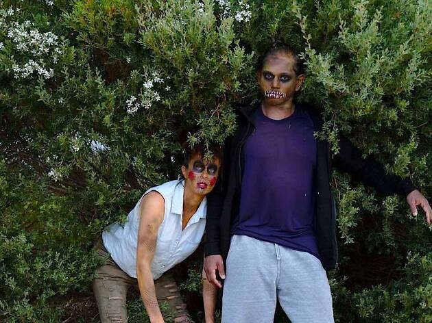Two people dressed in horror make-up.