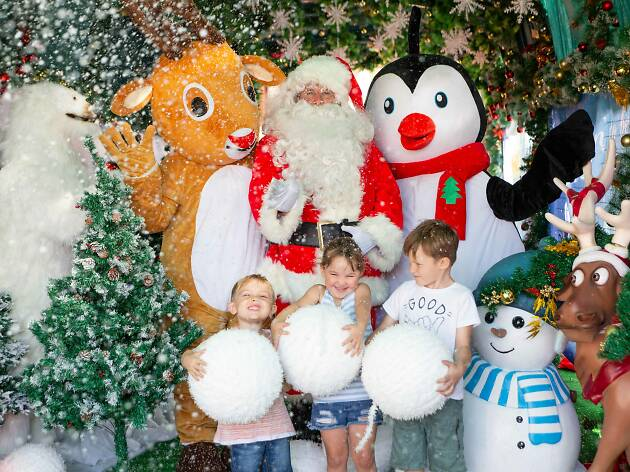 Kids posing with Santa.