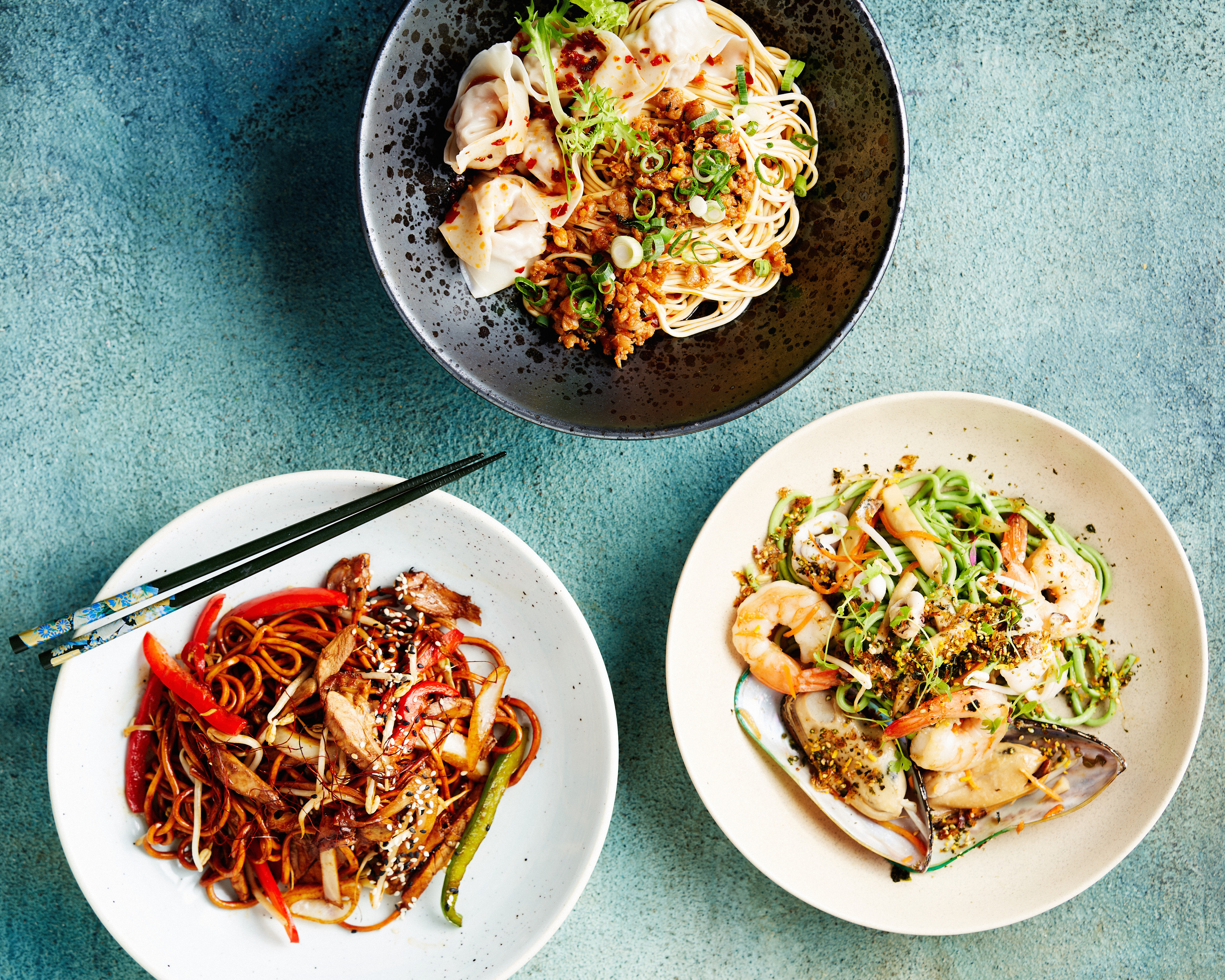 Stir fry dishes on a table.