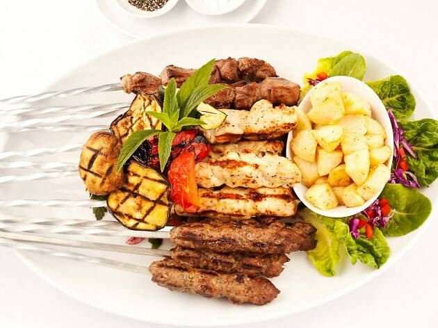 Plate of meat skewers and vegetables.