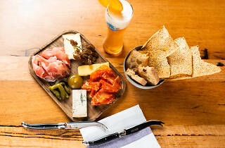 A charcuterie board and a beer