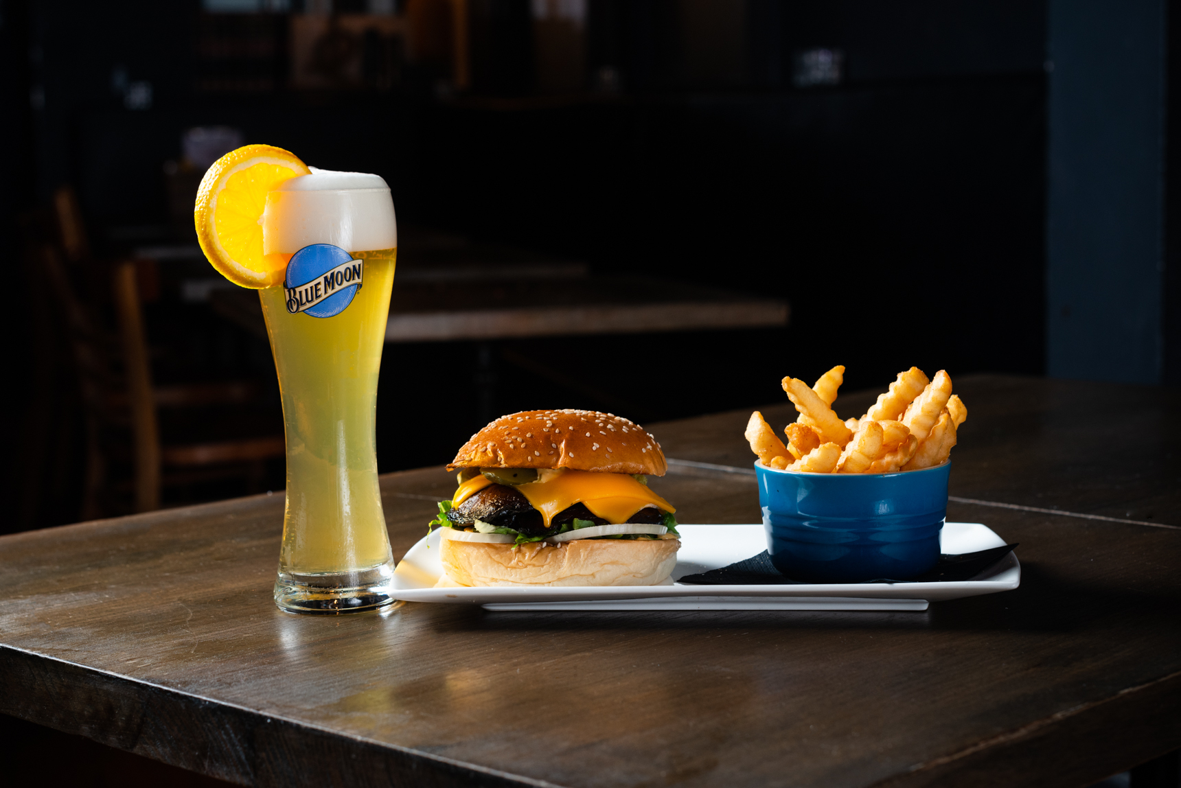 A Blue Moon beer and a mushroom burger and fries