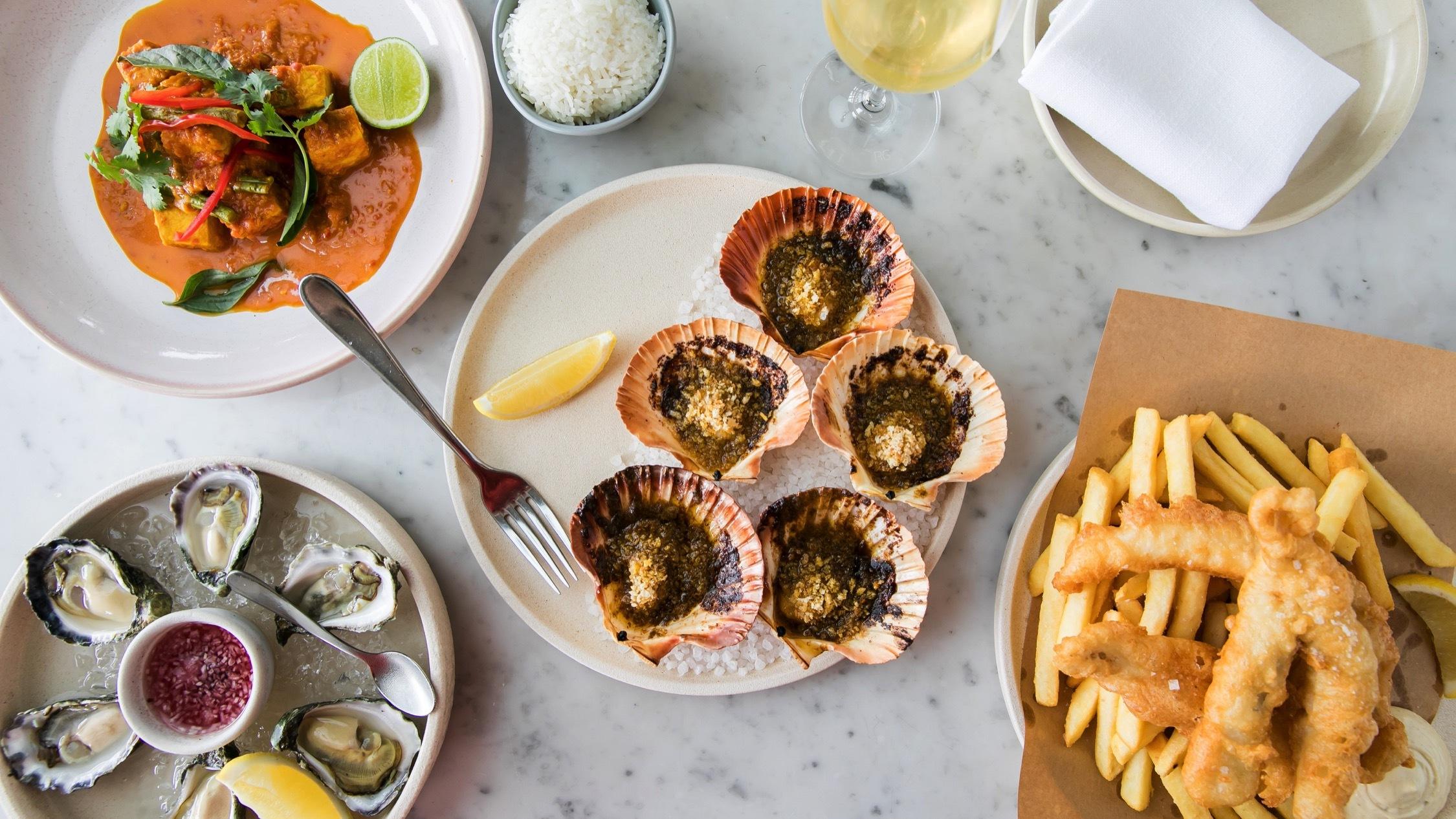 Table with plates of food at North Bondi Fish