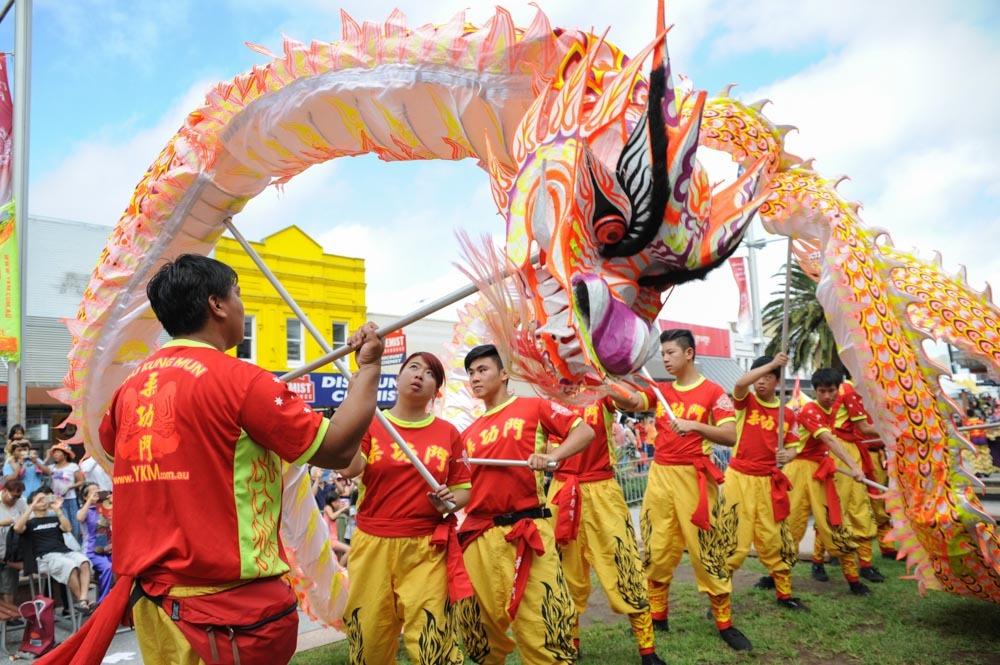 People dancing in dragon costume.