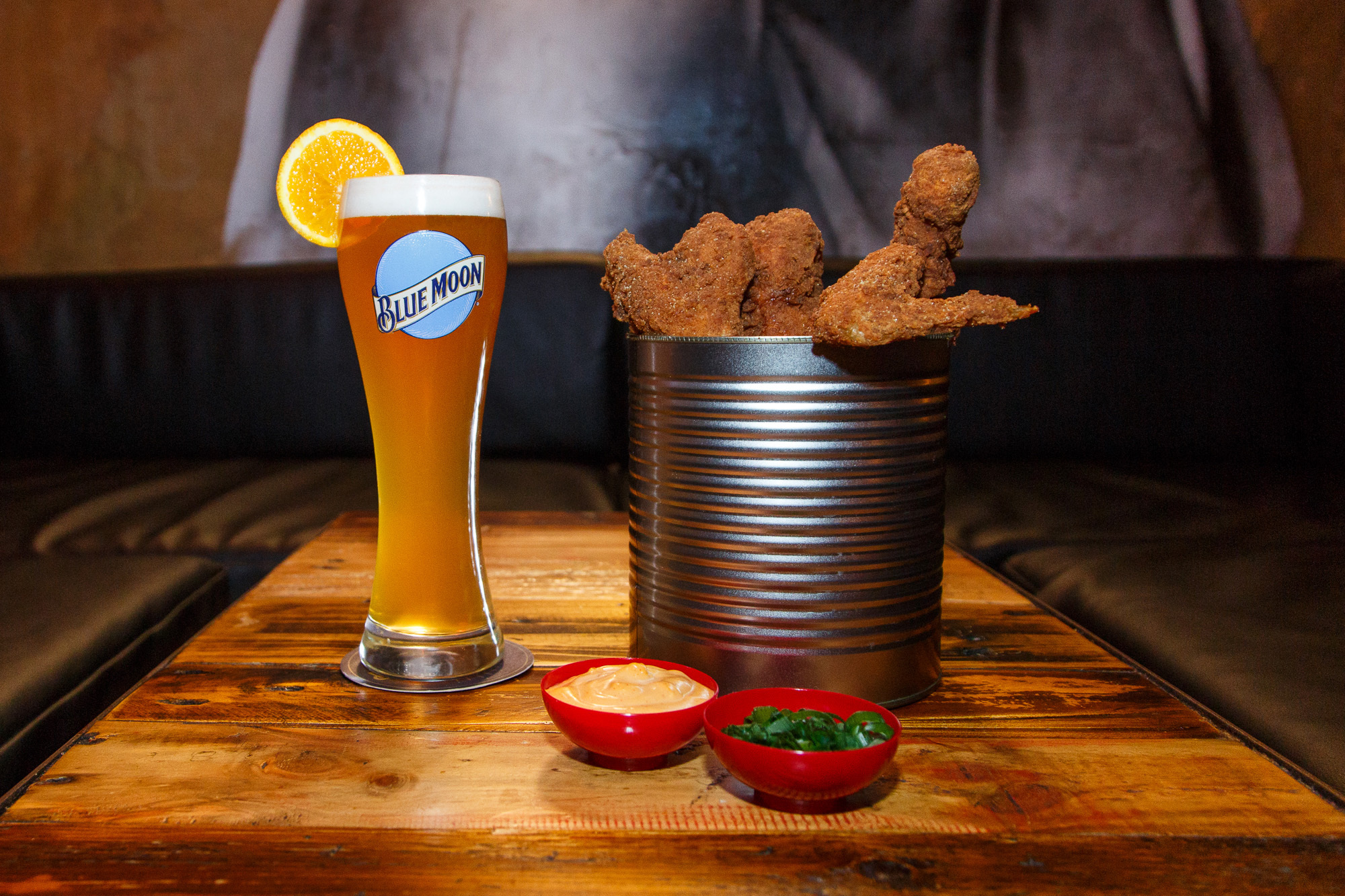 A bucket of fried chicken and a Blue Moon beer