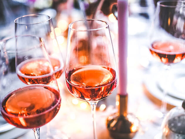 Glasses of rosé on a table.
