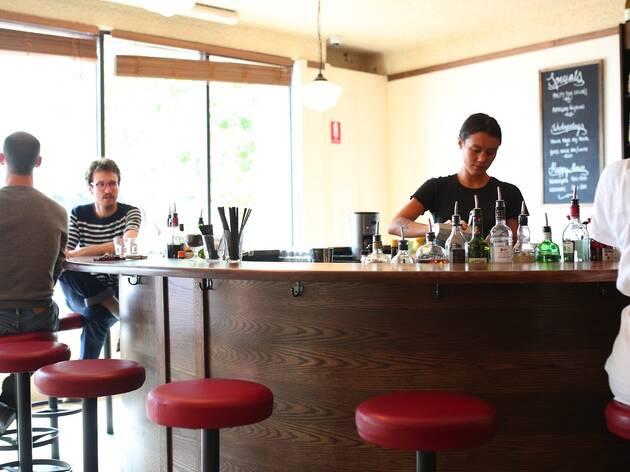 People sitting inside bar at Romantica