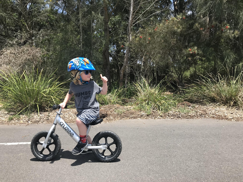 Kid riding a bike.