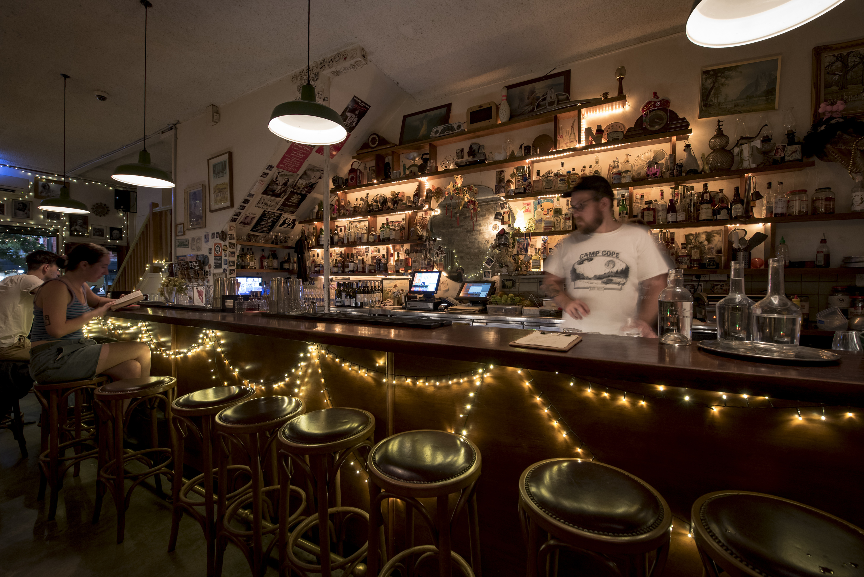 Bartender at Arcadia Liquors at night