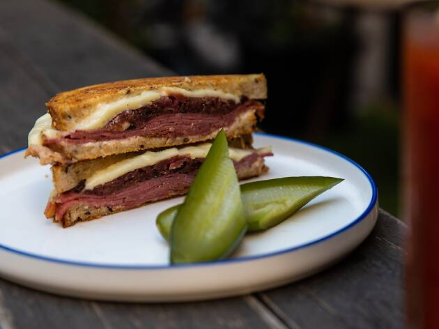 A reuben sandwich with pickles