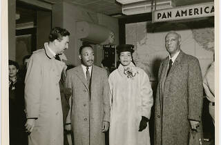 Dr. Martin Luther King, Jr. and his wife Coretta being greeted by Rev. Adam Clayton Powell, Jr. (left) and labor leader A. Philip Randolph (right) at the Pan American World Airways terminal, in New York City