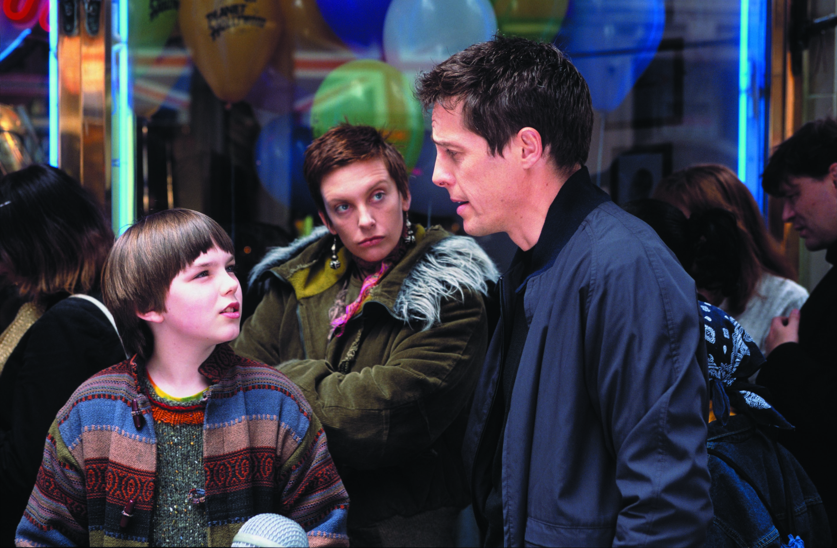 Hugh Grant, Nicholas Hoult and Toni Collette in About a Boy