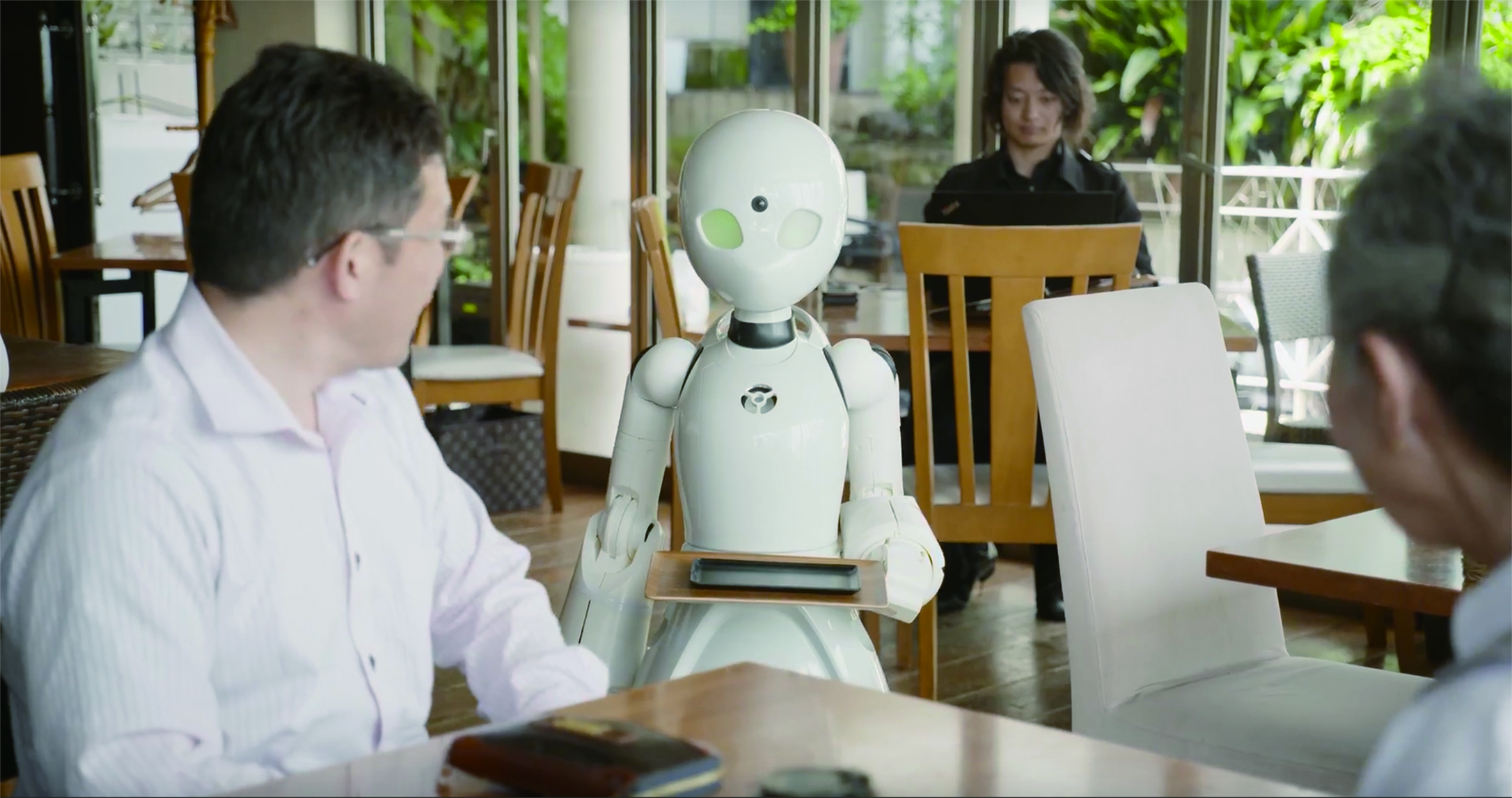 Pop-up cafe in Tokyo features robot waiters controlled by people with disabilities