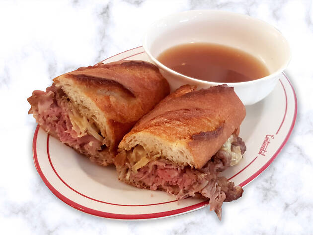 A roast beef sandwich with broth