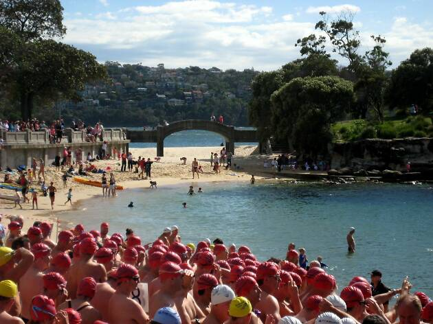 People ready for a swimming race.