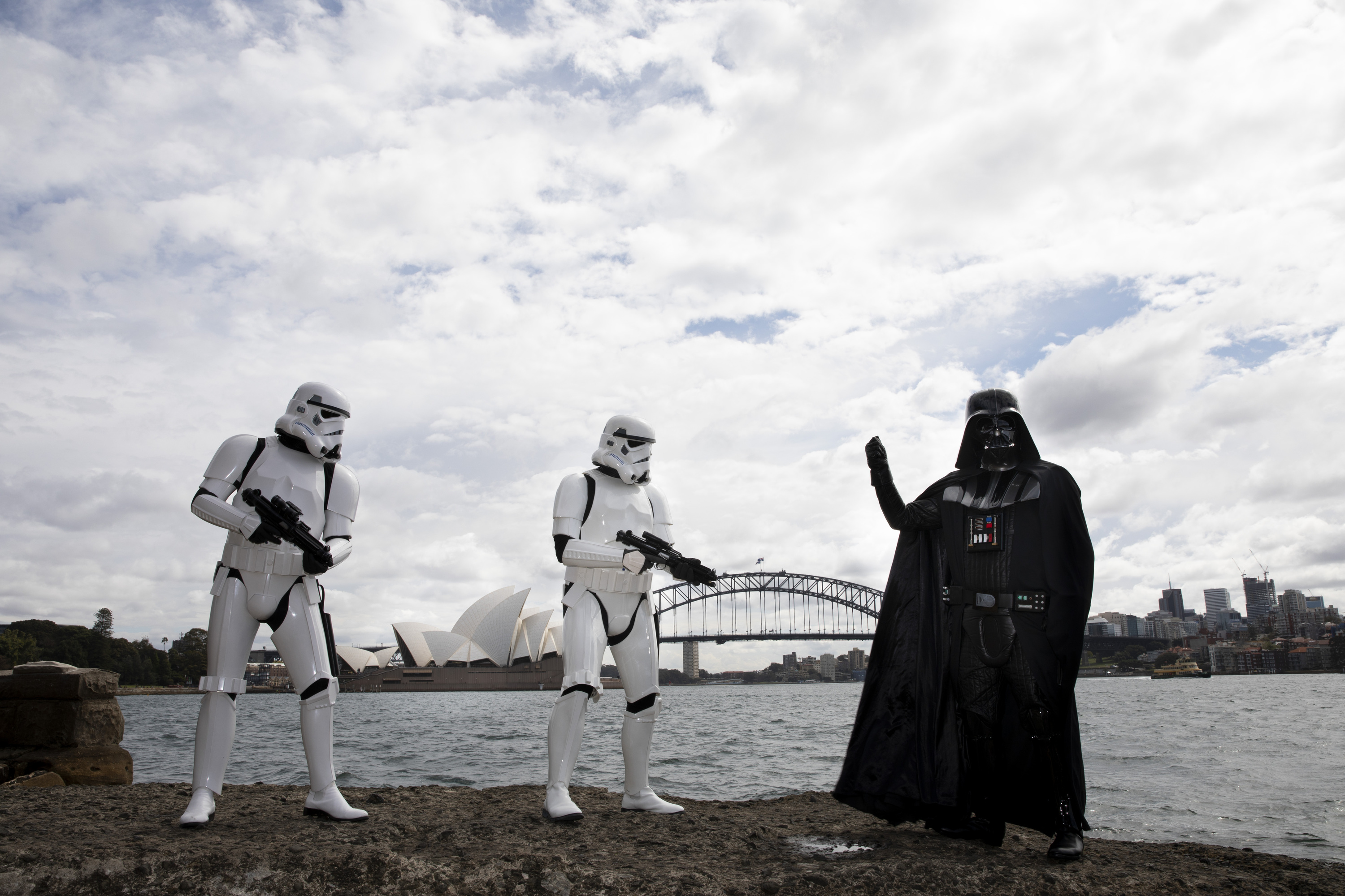 Characters standing in front of the Sydney Opera House and Harbour Bridge.