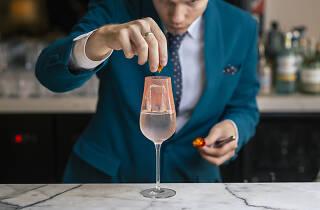 Bartender making a drink.