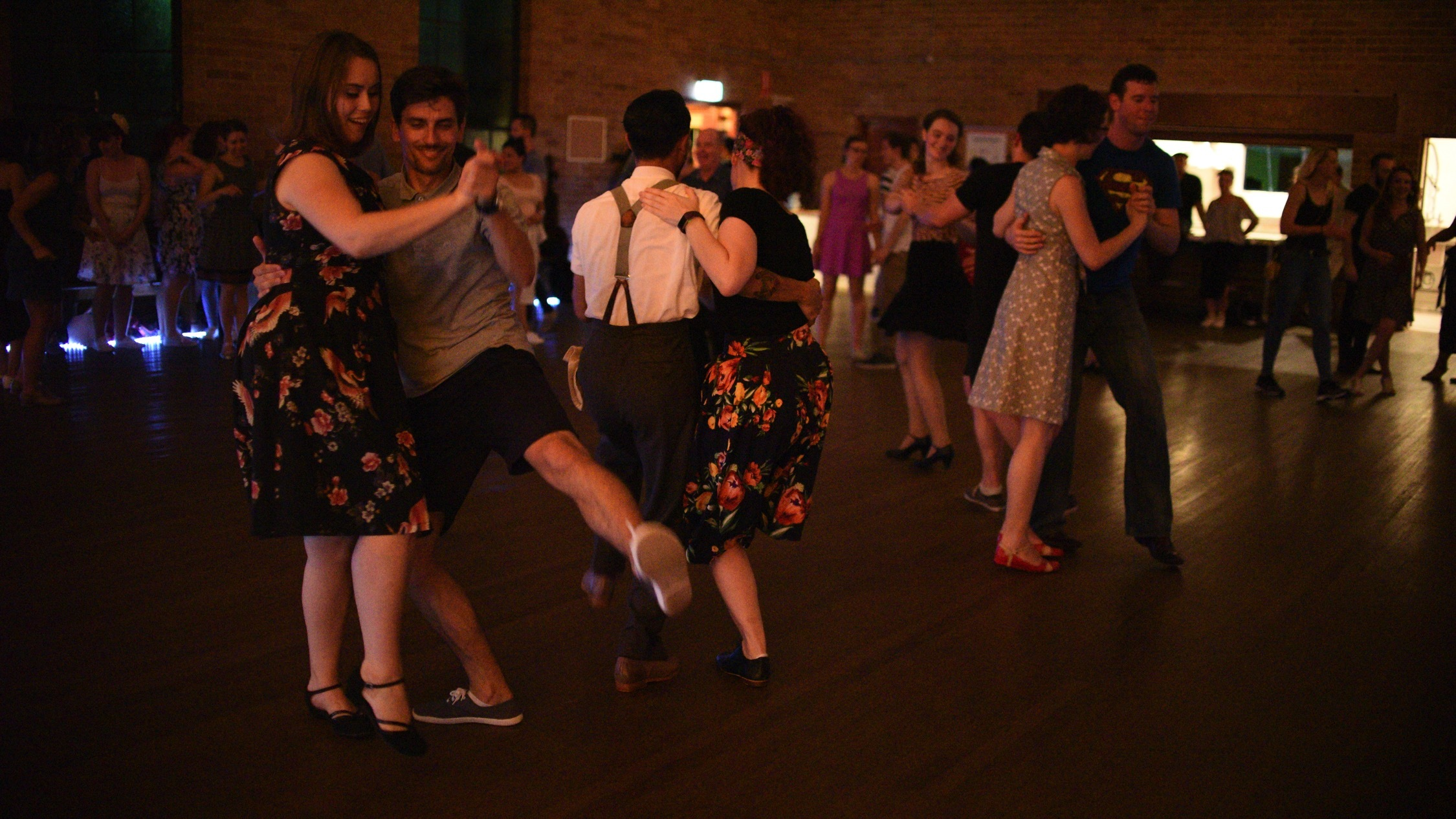 People dancing in a group at Swing Patrol Dance Class