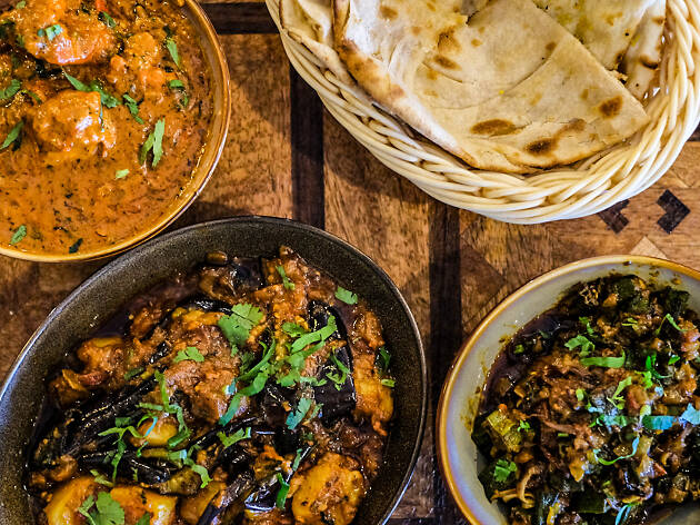 Three Indian curries and a basket of naan