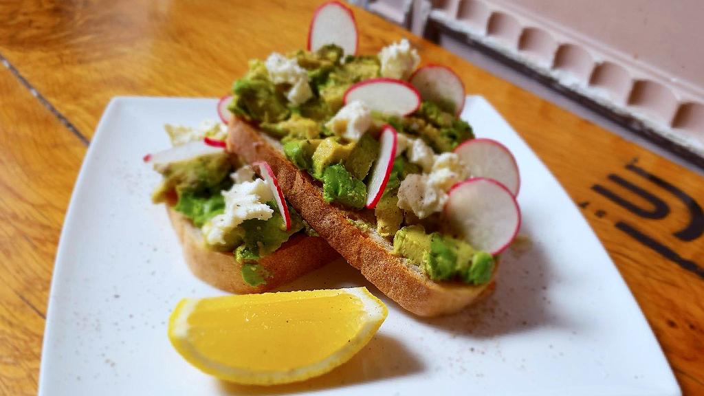 Avocado on toast with radish and lemon