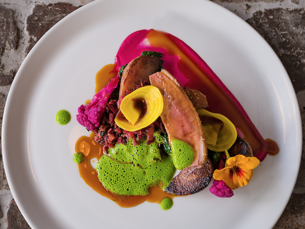 Duck dish with edible flowers and sauces