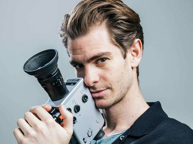 Andrew Garfield holding an old camera