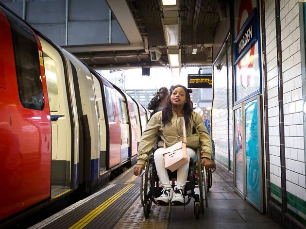 Woman in wheelchair on tube platform