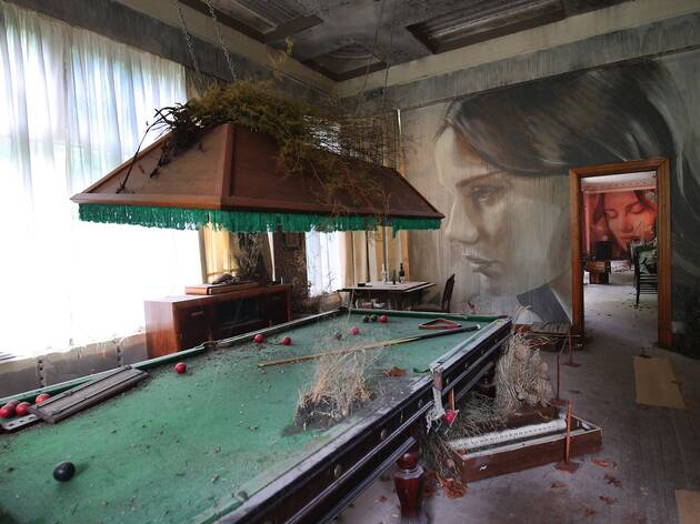 pool table Inside an abandoned house at Rone Street Art Exhibtio