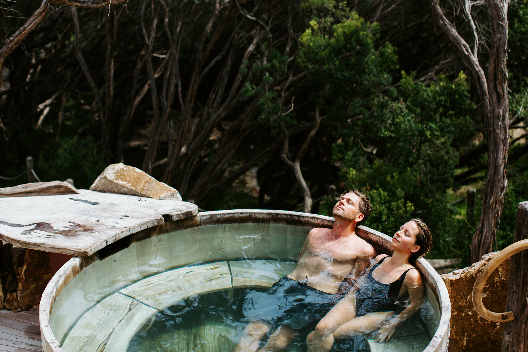 Two people bathing in a private pool at Peninsula Hot Springs