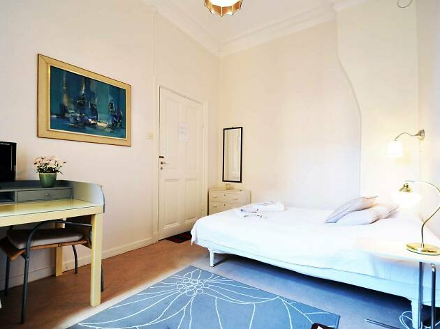 blue and white bedroom with abstract artwork on walls