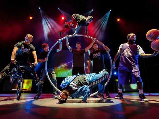 The 360 Allstars doing acrobatics on stage.