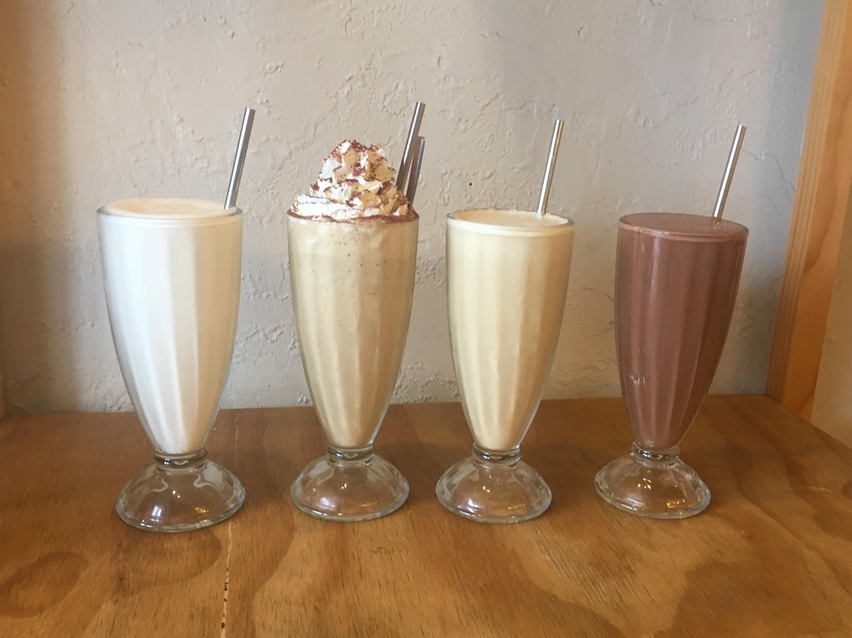 Four milkshakes in glasses