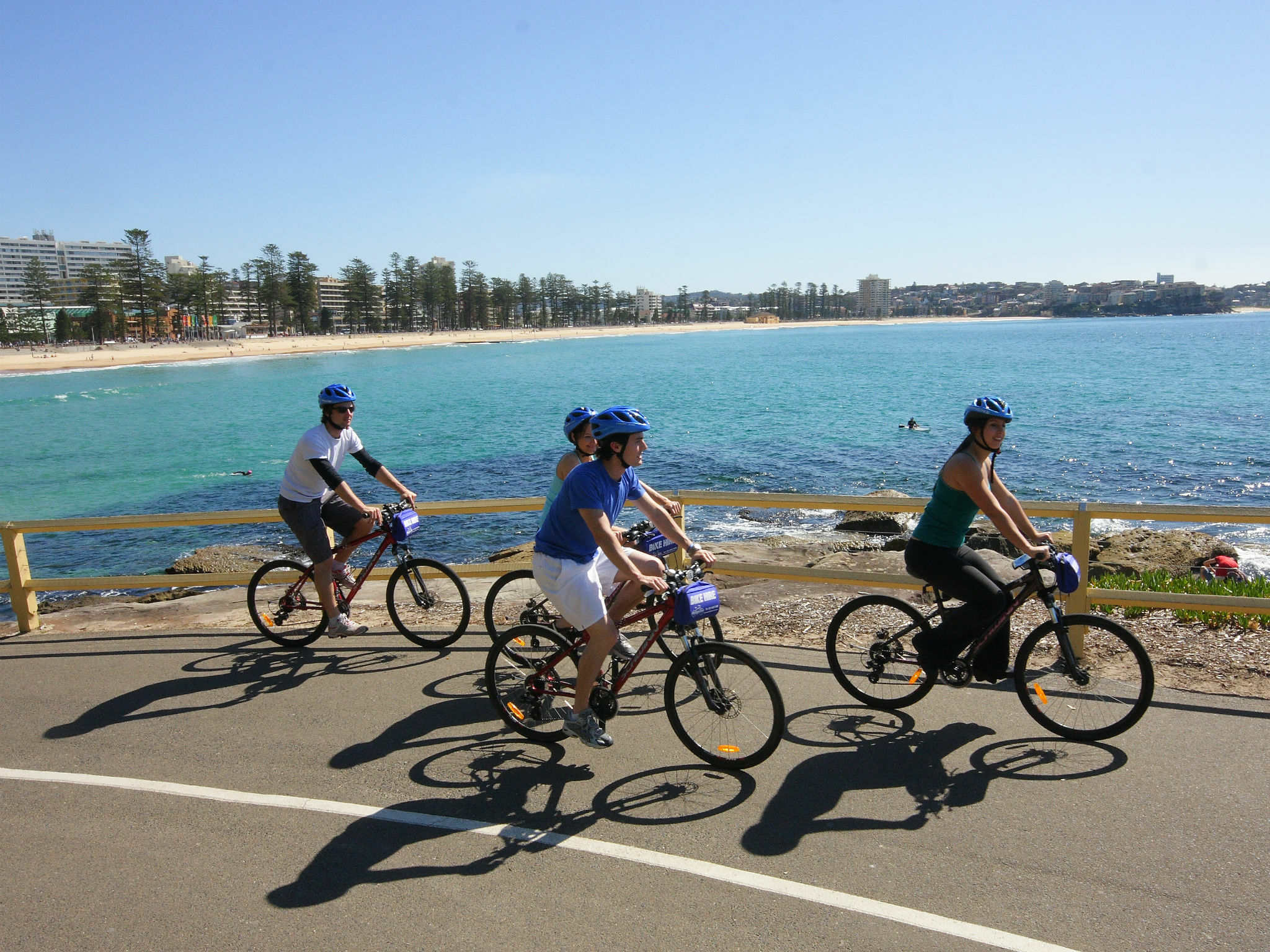 Group of people on a self-guided tour of Manly on bikes