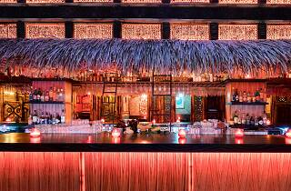 The bright tiki bar at Zombie Village